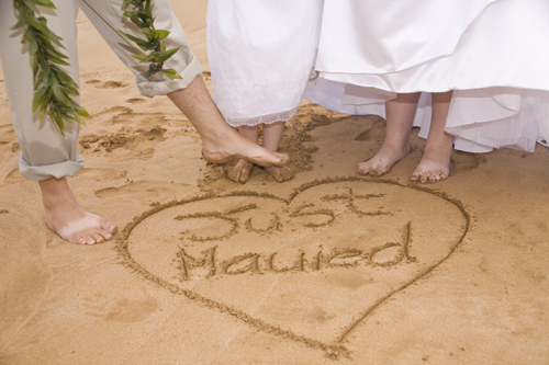 Hawaii wedding, couple feet in sand at maui beach wedding
