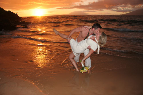 romanitic maui wedding couple kissing after their island beach wedding