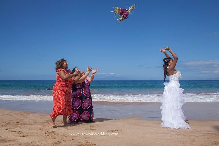 Another fun wedding on Maui. This bride really gave the bouquet a good toss! Guess who caught it though? www.hawaiiwedding.com Photo credit Kevin Rebelo.