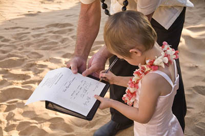 renew wedding vows on maui as girl signs certificate