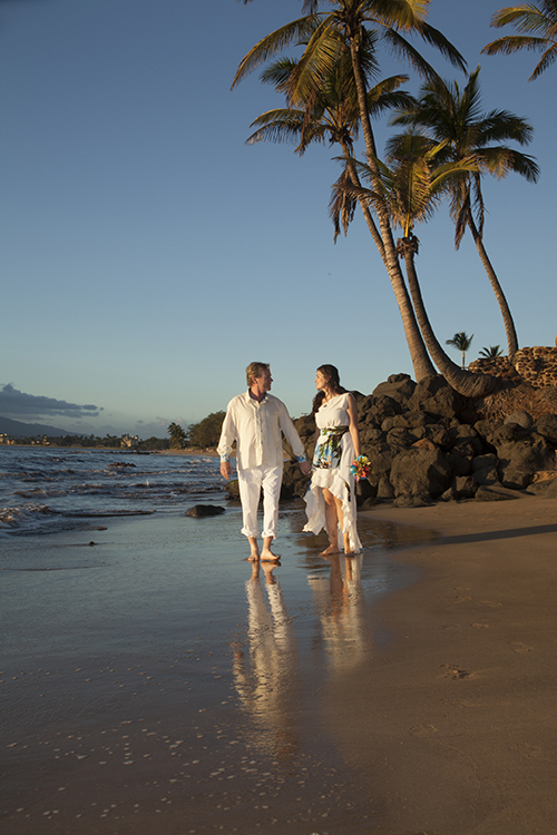 couple walking on sugar beach maui for their wedding