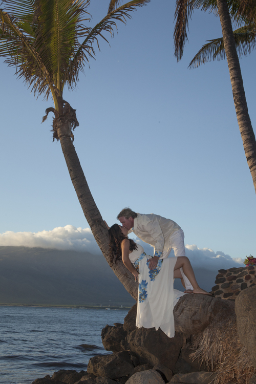 wedding couple in palm trees at sugar beach cove, maui