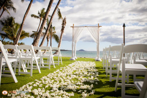 Arch and Chair set up at the Manakai Lawn in front of the Five Palms Restaurant