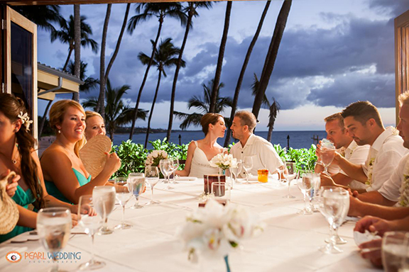 Couple at table for wedding reception at the Five Palms Restaurant on Maui