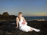 bride on rocks at Makena Cove Maui