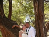 another wedding couple at a tree