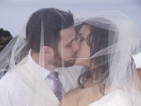 kissing through veil at Hawaii Wedding and Vow Renewal
