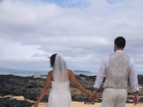 couple walks away from Maui Wedding