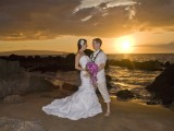posing for sunset wedding photos on Maui Beach