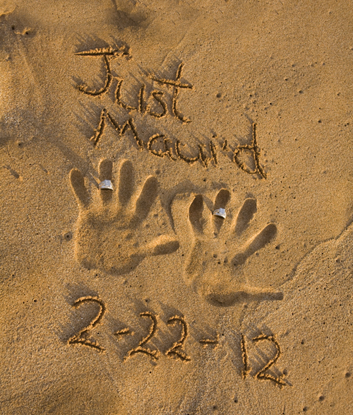 rings and hand print in the sand at lesbian maui wedding