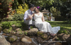 couple sits at the stream at the Maui Tropical Plantation