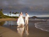 strolling couple at maui beach wedding