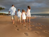 family walking on the beach at their vow renewal on maui
