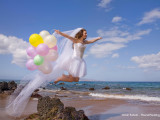 maui wedding bride flying with balloons