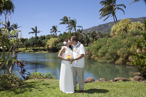 wedding at maui tropical plantation with lake in the background