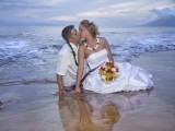 couple in water at maui wedding