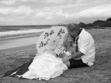 bride with umbrella at Hawaii beach wedding