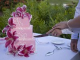 cutting wedding cake at hawaiian island wedding