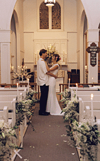 couple in aisle at country church for their maui wedding
