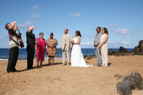 Maui hawaii wedding packages hawaii wedding maui wedding vow maui wedding ministers blowing conche at a hawaii wedding ceremony junglespirit Images