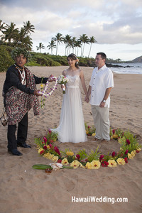 Hawaiian Minister Performing A Beach Wedding On Maui