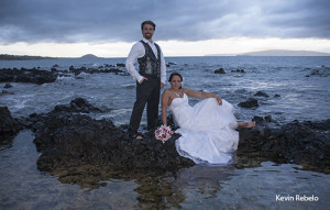 maui wedding photographer takes photo of couple on rocks on Maui beach